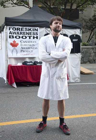 CAN-FAP founder and foreskin performance artist Glen Callender outside the Foreskin Awareness Booth
